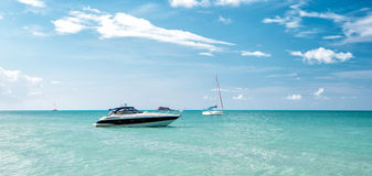 Attractive bright view of exotic colorful beautiful marine beach with boat on blue water Royalty Free Stock Photo