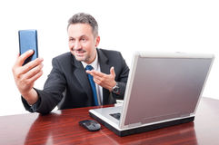 Attractive broker taking self portrait Royalty Free Stock Photography