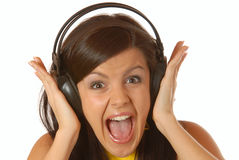 Attractive brown hair girl listening to music Stock Photography
