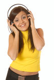 Attractive brown hair girl listening to music with headphones Royalty Free Stock Image