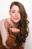 Attractive Brown  Hair Model Blows Kiss Stock Photos
