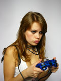 Attractive brown-haired woman plays video game. Young nice girl plays video game Stock Photography
