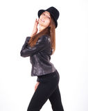 Attractive brunet businesswoman in a black leather jacket Stock Photo