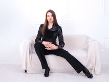 Attractive brunet businesswoman in a black leather jacket Royalty Free Stock Image