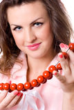 Attractive brunet woman with red beads Stock Photos