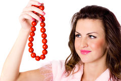 Attractive brunet woman with red beads Royalty Free Stock Images