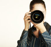 Attractive brunette aims her camera. Stock Photography