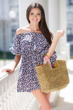 Attractive brunette with a bag in a big city. Royalty Free Stock Photo