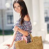 Attractive brunette with a bag in a big city. Royalty Free Stock Images