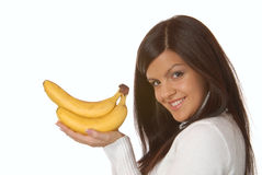 Attractive brunette with banana Stock Photography