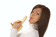 Attractive brunette with banana Stock Images