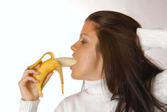 Attractive brunette with a banana Stock Photo