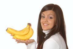 Attractive brunette with a banana Stock Photography