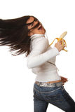 Attractive brunette with a banana Royalty Free Stock Photography