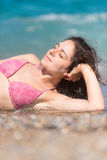 Attractive brunette at the beach Royalty Free Stock Photos