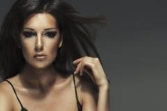 Attractive brunette beautiful woman posing Stock Photos
