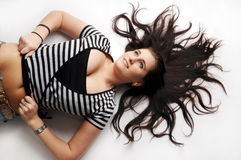 Attractive brunette in black and white T-shirt Stock Photography