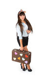 Attractive brunette with a bow on her head with a suitcase in ha Royalty Free Stock Photos