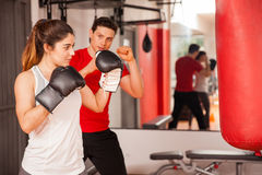 Attractive brunette boxing at the gym Royalty Free Stock Image