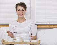 Attractive Brunette with Breakfast in Bed Royalty Free Stock Images