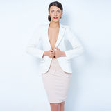 Attractive brunette business woman wearing jacket Stock Image