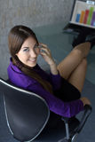 Attractive brunette businesswoman calling Royalty Free Stock Images