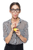 Attractive brunette businesswoman drinking lemon juice Stock Photography