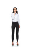 Attractive brunette businesswoman in formalwear showing silence symbol. Isolated on white Royalty Free Stock Photos