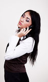 Attractive brunette calling by mobile Stock Images