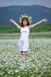 Attractive brunette in chamomile wreath Stock Images