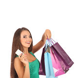 Attractive brunette with credit card in hand Royalty Free Stock Photography