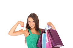 Attractive brunette with credit card in hand Stock Images