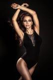 Attractive brunette dancing Stock Images