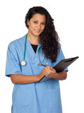Attractive brunette doctor with a clipboard Royalty Free Stock Image