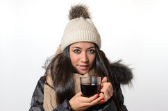 Attractive brunette enjoying a mug of hot tea Stock Photos