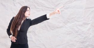 Attractive brunette female manager indicate something Royalty Free Stock Image