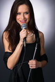 Attractive Brunette Female Musical Vocalist Karaoke Singer Audio Royalty Free Stock Photography