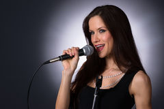 Attractive Brunette Female Musical Vocalist Karaoke Singer Audio Royalty Free Stock Images