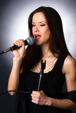 Attractive Brunette Female Musical Vocalist Karaoke Singer Audio Royalty Free Stock Image