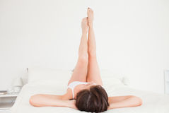 Attractive brunette female stretching her legs Stock Photos