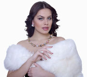attractive brunette in a fur coat Royalty Free Stock Photos