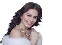 Attractive brunette in a fur coat Stock Photos