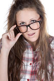 Attractive Brunette Geek Holding her Glasses Royalty Free Stock Photography