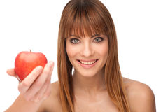 Attractive brunette girl with an apple Stock Photos