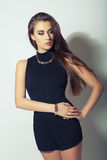 Attractive brunette girl in black clothes Stock Images
