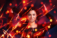 Attractive brunette girl with bokeh lights Stock Photo