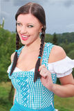 Attractive brunette girl in a dirndl . Royalty Free Stock Photography