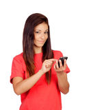 Attractive brunette girl dressed in red with a mobile Stock Photography
