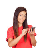 Attractive brunette girl dressed in red with a mobile thinking Stock Photos