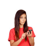 Attractive brunette girl dressed in red with a mobile thinking Royalty Free Stock Image
